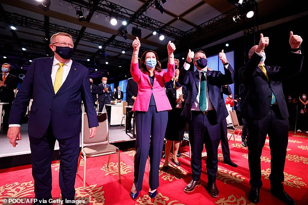 Leaders hope the Brisbane Games will put Brisbane on the global map in the same way Sydney was after the Harbour City's world-renowned effort in 2000 (pictured, Queensland Premier Annastacia Palaszczuk celebrates in Tokyo)