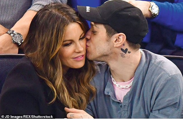 Cat's out of the bag:Kate and Pete's relationship went public when they were spotted kissing in the stands at a hockey game in New York City in March 2019 (pictured)