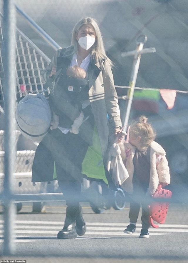 Jack De Belin's girlfriend Alyce Taylor arrives at Coolangatta airport with their two young children on Wednesday afternoon.Daily Mail Australia is not alleging Ms Taylor broke bubble rules