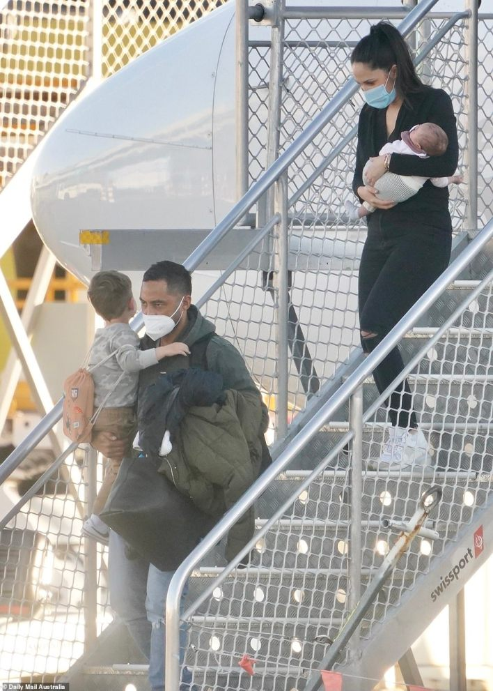 South Sydney Rabbitohs star Benji Marshall (left) and wife Zoe (right) arrived later on Wednesday afternoon. Marshall chose not to fly to Sydney with his teammates last week so he could be with his newborn daughter (pictured).Daily Mail Australia is not alleging the Marshalls broke bubble rules