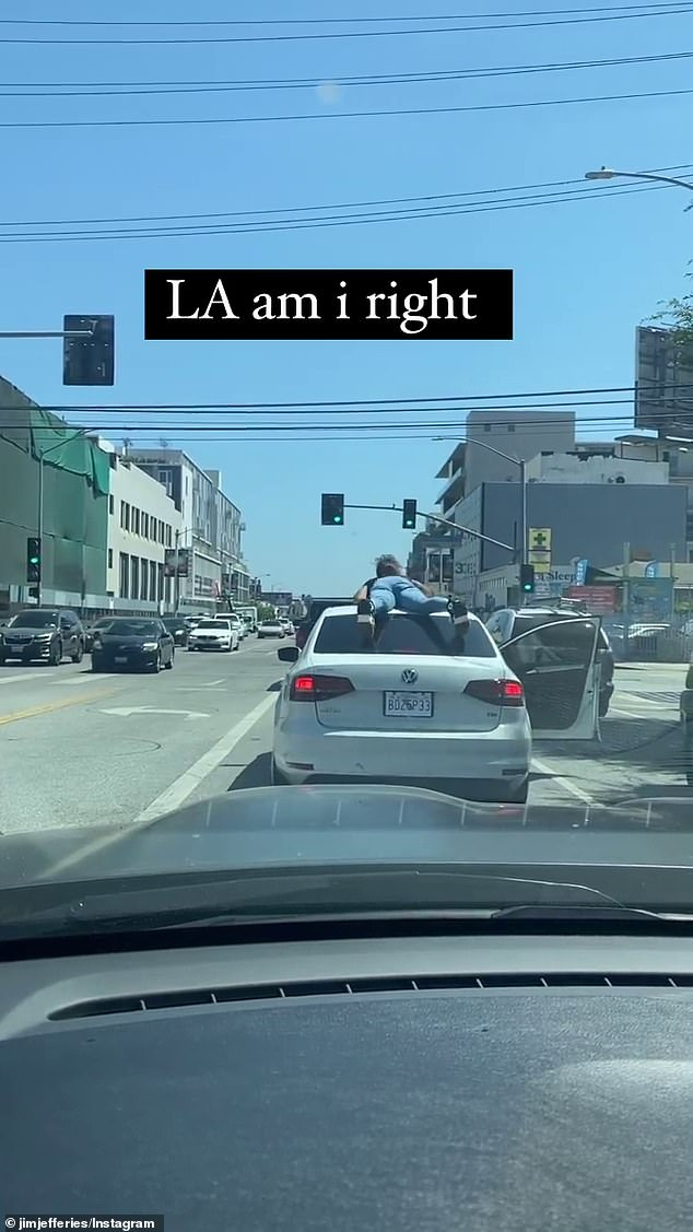 Strange: The funny man, who was stuck in traffic behind the woman, filmed her antics as she danced in front of other motorists.  When the lights at the intersection turned green, the woman dropped from her dance position and lay down on top of the car