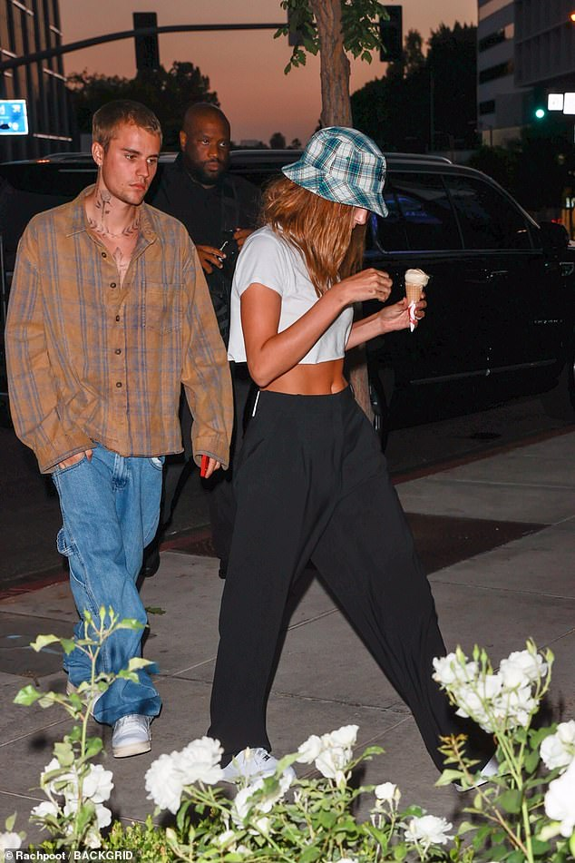 She's got style: Hailey complemented her flashing tee with a Stussy plaid bob and loose black sweatpants