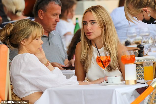 Date:The 30-year-old swimwear designer sported a white top and a silver-and-gold ring as she chatted away with a friend at the high-end brasserie