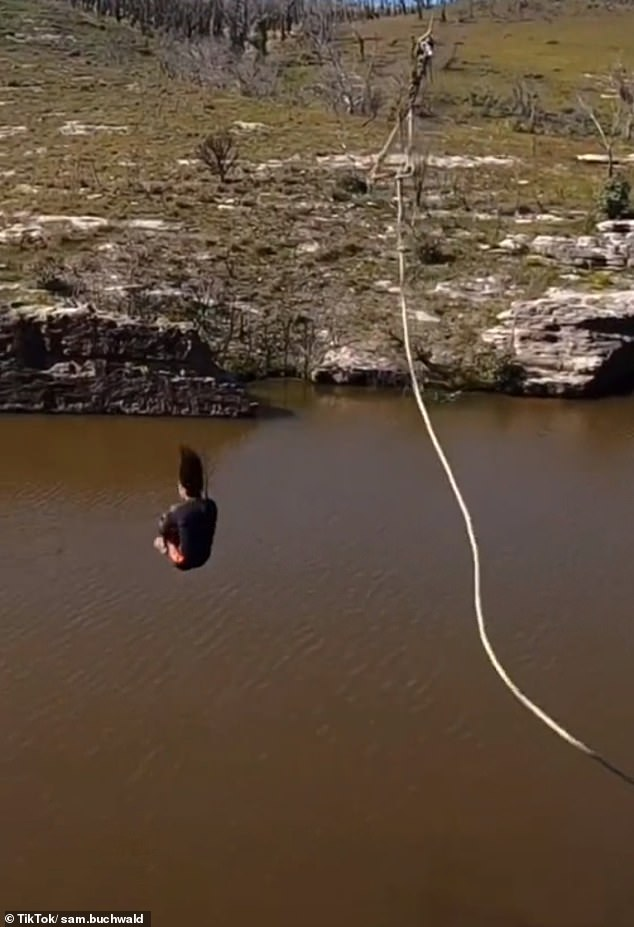 The brash stuntman launched himself off the cliff and tipped over three times before landing heavily on his back on the 'concrete' water surface