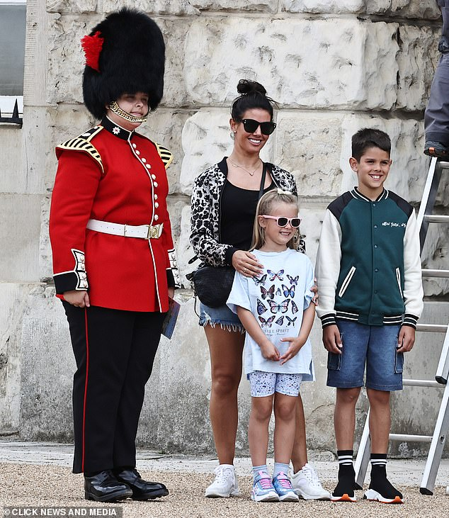 Sweet: Rebekah Vardy adored her daughter Sofia, six, and son Taylor, ten, as they were sightseeing while enjoying a family day out in London last week