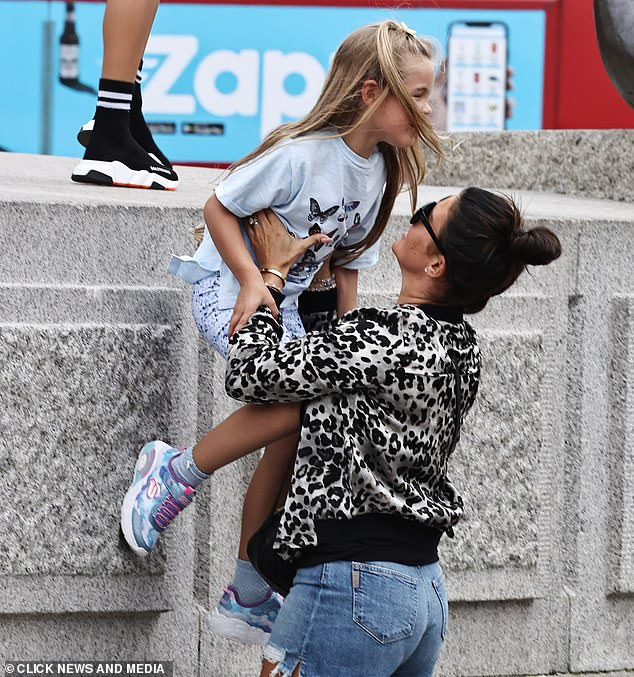 Got it: Rebekah was seen holding Sofia as she tried to climb down a ledge in Trafalgar Square