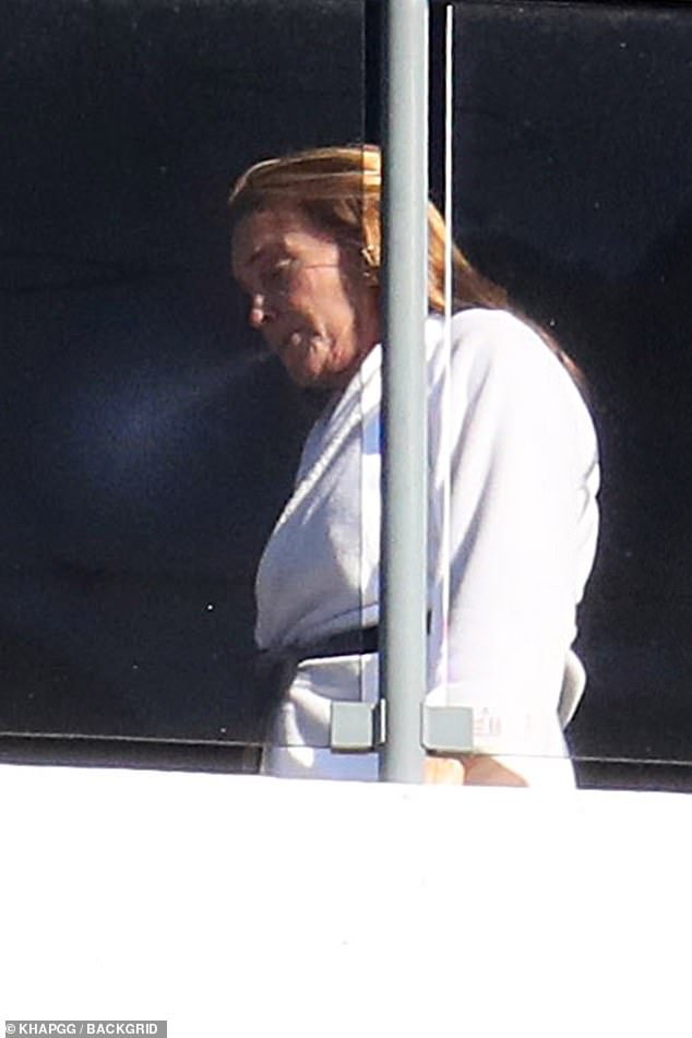 Puffing away: Caitlyn Jenner was spotted smoking a sneaky cigarette while in mandatory hotel quarantine in Sydney on Thursday
