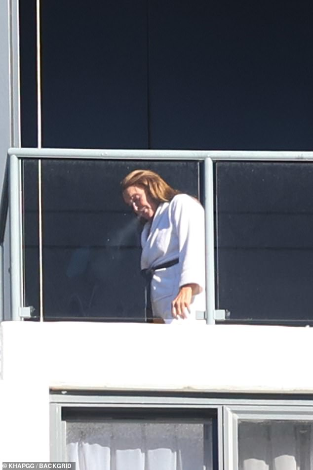 Cigarette break: The 71-year-old US reality TV star stepped out onto her balcony to smoke ahead of her upcoming appearance on Big Brother VIP