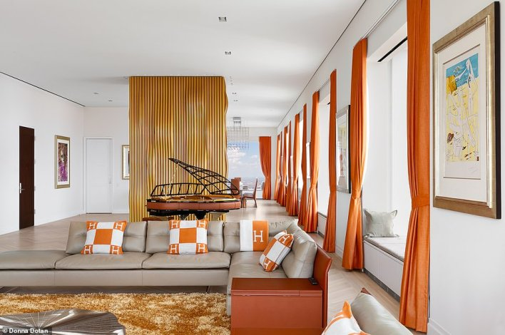 It also features 240 linear feet of glass.  The furniture and art are included in the sale of the penthouse