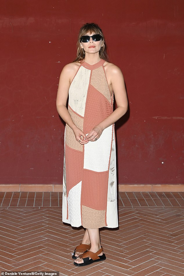 Fashion maven: Elizabeth, 32, meanwhile looked stunning in a patchwork dress and some dark blacks zwarte