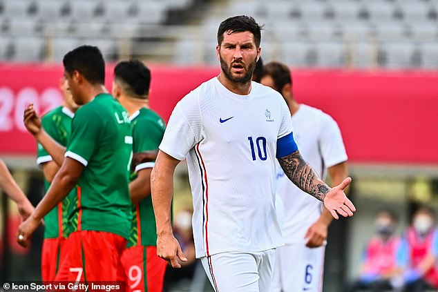 France's Pierre-Andre Gignac looks on in horror as his side is beaten 4-1 by Mexico in Tokyo in