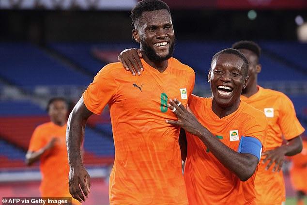 AC Milan's Franck Kessie (left) celebrates with Max Gradel after scoring the Ivory Coast winner