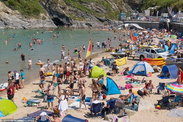 A busy Towan Beach crowded with holidaymakers enjoying their summer holiday in Newquay, Cornwall, today