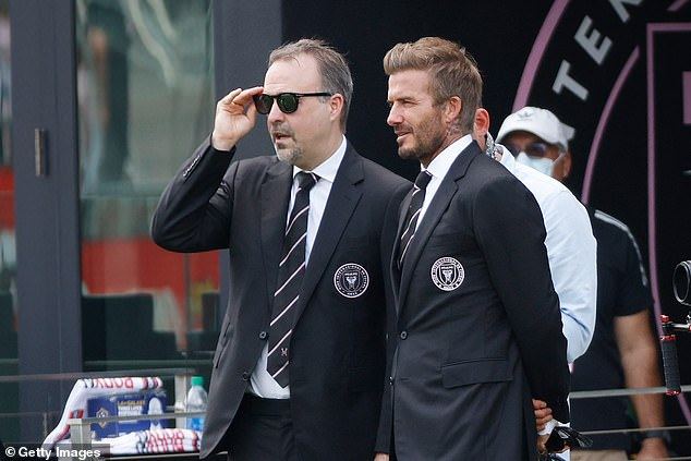 Beckham (right) may have to judge his good friend Neville very harshly