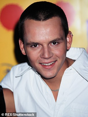 Before: Paul previously wore a buzzcut when he was in the pop group (pictured in 1999 - the year the band released their first single Bring It All Back)