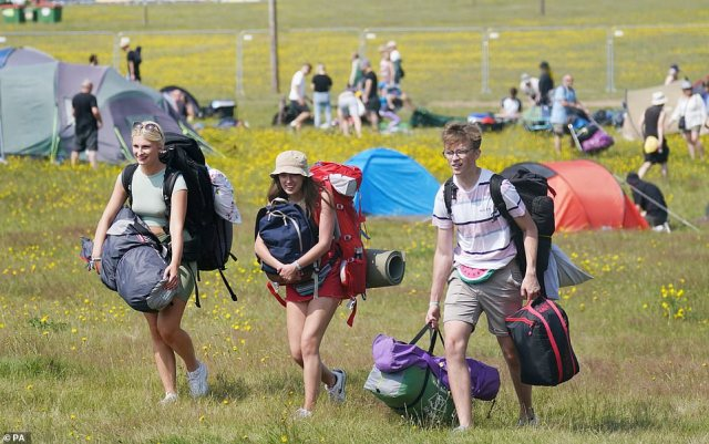 A group of happy campers arrive on site in Henham Park, Southwold, Suffolk, ready for this weekend's Latitude festival