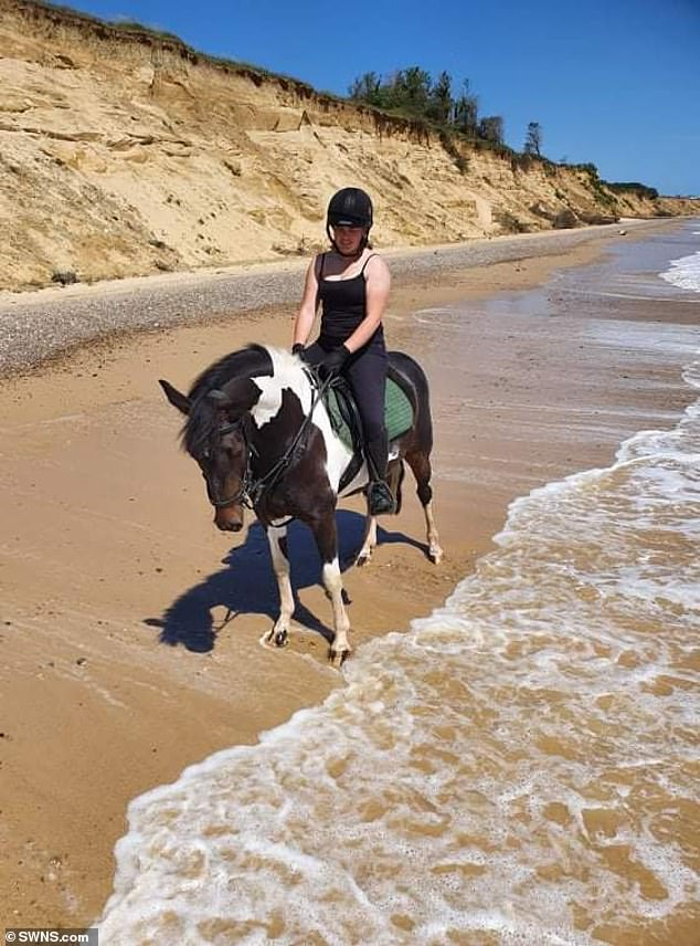Her owner Louise Knock, 41, pictured on Marge on the beach, is often bombarded with phone calls from concerned neighbors telling her her horse has died