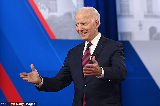 President Joe Biden (pictured at a CNN town hall on Wednesday) is also considering recommending Americans, regardless of vaccination status, return to wearing masks indoors, a new report revealed