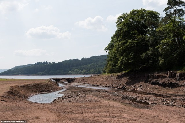 Water levels continue to drop at the Llwyn Onn reservoir in South Wales, pictured today, as the heatwave continues