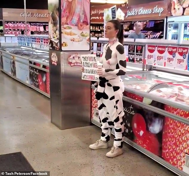 In another stunt, the vegan militant went topless and painted himself in cow print to protest outside a butcher's shop