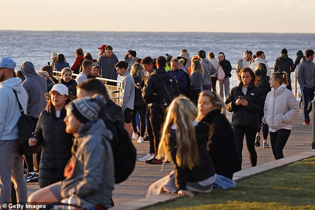 A further 124 Covid-19 cases were registered in NSW on Thursday, 48 of which are still contagious in the community and 57 have yet to be linked to known clusters.  (pictured Bronte Beach is seen packed with crowds on Thursdays)