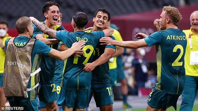 Marco Tilio from Australia celebrates scoring their second goal with teammates