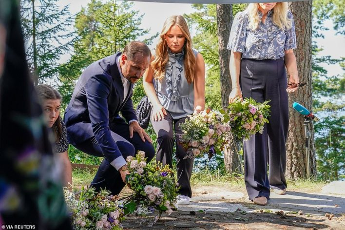 Norway's Crown Prince Haakon and Princess Ingrid Alexandra lay flowers at a memorial as it marks the 10th anniversary of the bombing of the islands of Oslo and Utoeya
