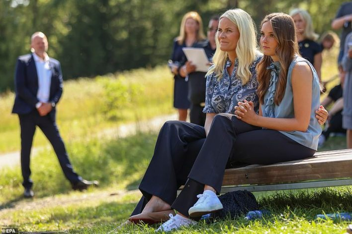 Norway's Crown Princess Mette-Marit (left) and Princess Ingrid Alexandra (right) attend a memorial service on Thursday
