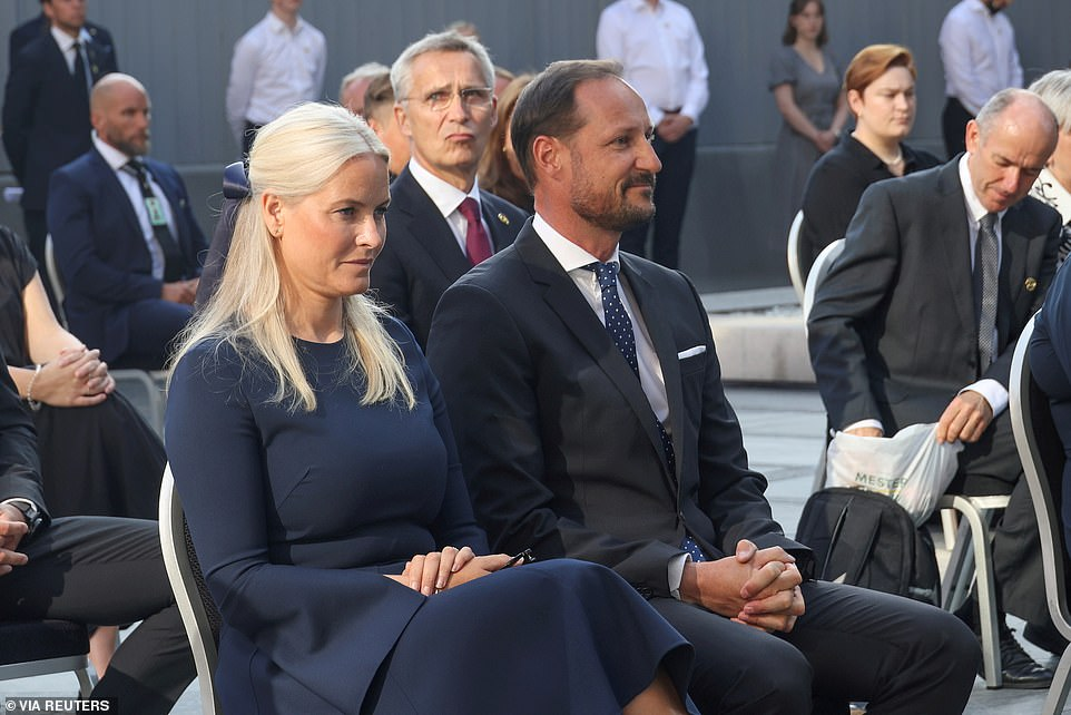 Norway's Crown Prince Haakon and Crown Princess Mette-Marit attend a memorial service in the Government Quarter