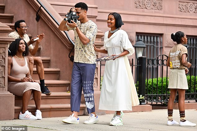 Sharing the scene: Union was later spotted with her co-star Keith Powers, who was seen with an old camera