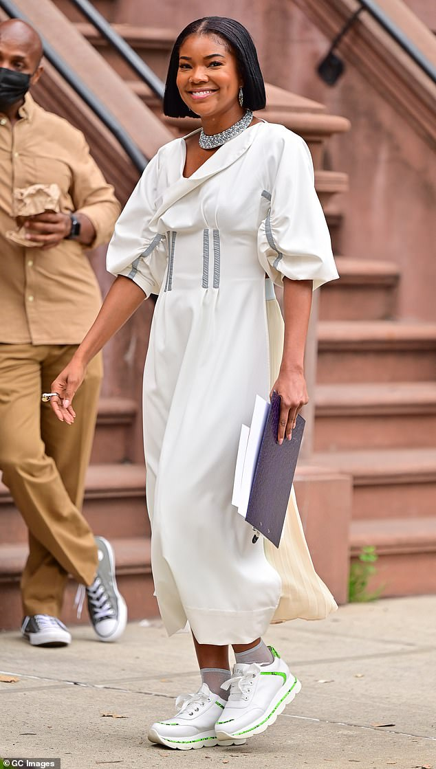 Walking at work: Gabrielle Union was seen walking on the set of the upcoming Netflix movie The Perfect Find in Harlem on Wednesday afternoon