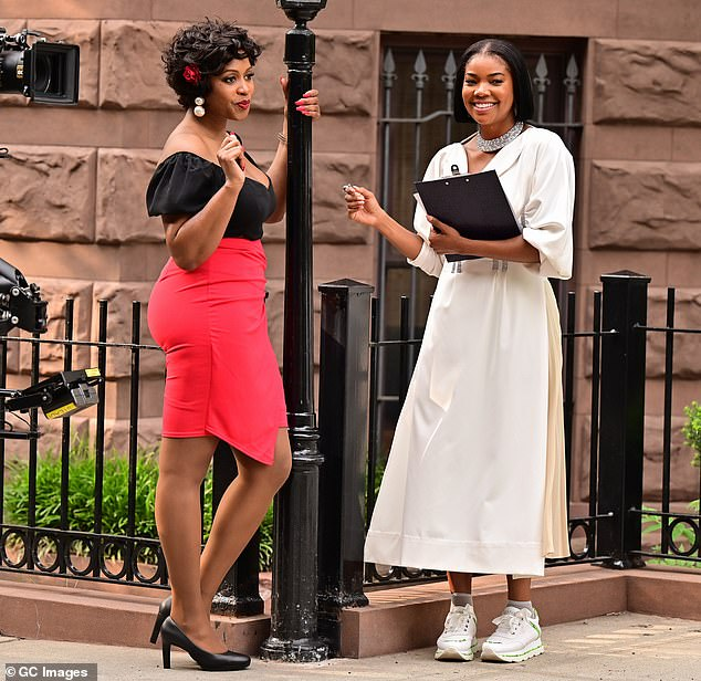 Catching up: The performer was later pictured spending time with her co-star Remy Ma, who opted for a 50s throwback look