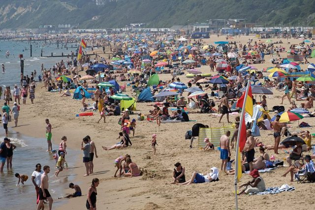 Families continued to flock to Bournemouth beach in Dorset today as southern England experiences very hot temperatures