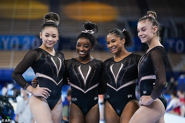 Lee, Biles, Chiles, and McCallum all wore matching black and rose gold leotards inspired by the Tokyo 2020 torch. GK said have a 'dynasty' theme