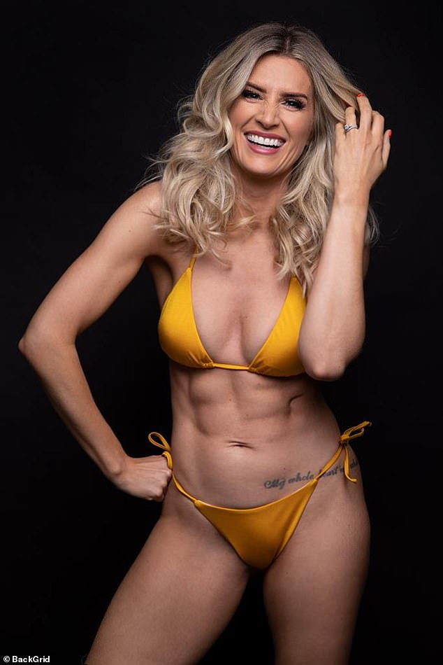 Wow: Sarah Jayne Dunn puts on a sizzling display as she flaunted her sensational abs in an orange bikini for a racy new photoshoot