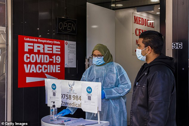 A health worker in a medical centre in Lakemba which offers Covid-19 vaccines on Thursday (pictured) amid a looming tightening of restrictions for the area