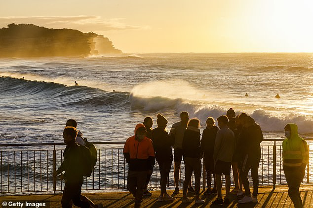 People gathering together at Bronte Beach in the city's eastern suburbs on Thursday (pictured) despite rule dictating people can only exercise in groups of two