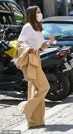 Stylish: Angelina also had a matching beige jacket that she took off in the sun