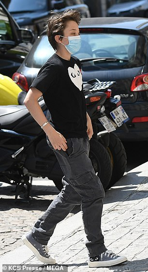 Matching: Shiloh wore Converse trainers and a shirt with the Commes des Garcons logo on it
