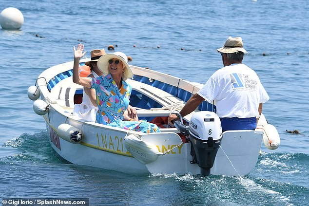 Off she goes: Trudie beamed a smile and waved for the cameras while on the boat with American starGina