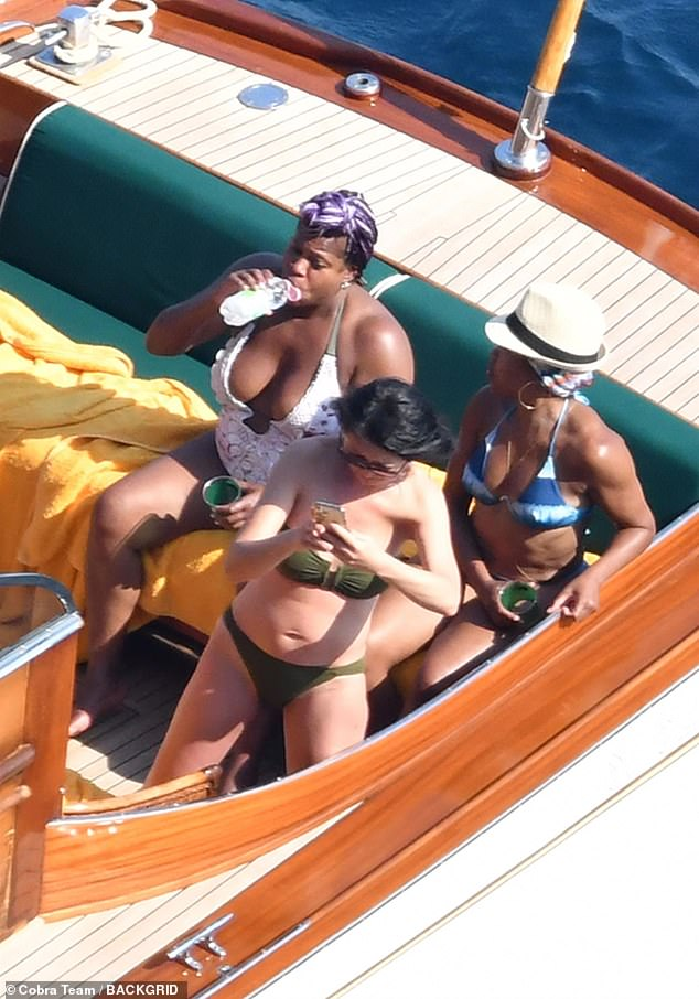 Producing Partners: The younger sister of four-time Emmy winner Reina (L) sipped water while dressed in a white low-cut swimsuit