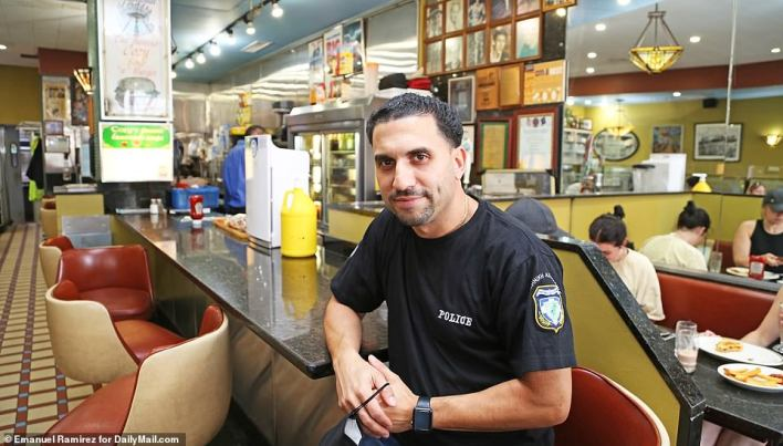 John Stratidis, the manager ofThe Famous Cozy Soup 'n' Burger diner in Manhattan's Greenwich Village, told DailyMail.com on Thursday that raising wages would punish consumers and eventually put people off dining out.'You're going to be walking in somewhere to eat something and paying$40 or $50 for a hamburger,' he said
