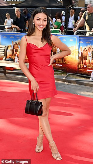 Pretty: She put on a confident display as she hit the red carpet