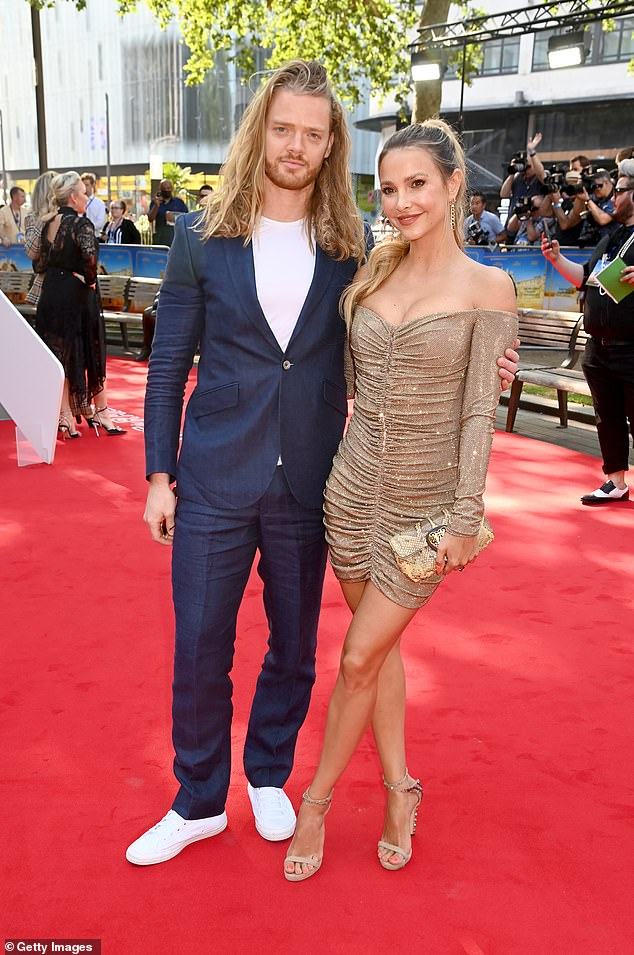 Cosyed up:Sophie Hermann, 34, seems to be over her breakup as she was pictured cosying up to her co-star Fredrik Ferrier, 32, at the Off The Rails premiere Leicester Square on Thursday
