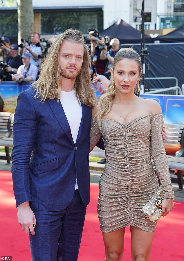 Stellar 'do':She wore her long blonde locks in a fluffy high ponytail, leaving a few strands down at the front to frame her face whilst Fredlet his Viking-like tresses fall down onto his shoulders