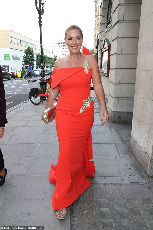 Looks stunning: Also in attendance was TV favorite Claire Sweeney, who looked glamorous in a figure-hugging red dress with jewel detailing across the waist and shoulder