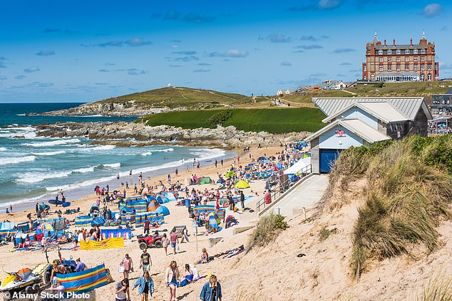 Cases in the county are at their highest yet, with over 2,000 cases recorded between July 10 and July 16 - up from the previous record of 1,997 (pictured: Fistral Beach in Newquay)