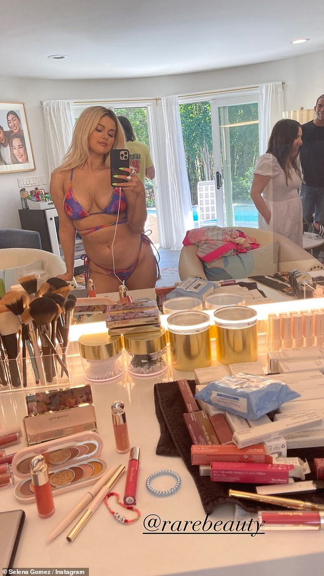Her line: Gomez modeled one of the bikinis when showing off her rare makeup line