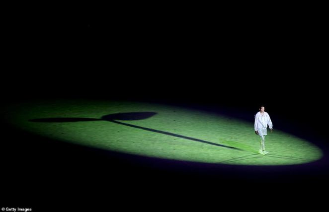 The image of a single athlete rising from the ground with a plant shoot behind them began the opening ceremony, symbolizing hope that springs anew in the face of adversity