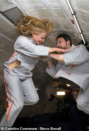 Pictured:Vanna Bonta and her husband test the 2Suit concept in zero gravity